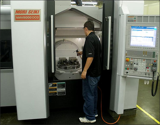 An employee working one of Habco's 5 axis mills
